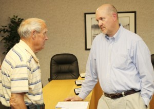 Scott Power (right) of the North Carolina Department of Cultural Resources chats with a local resident following Wednesday's meeting in Winton. Staff Photo by Cal Bryant