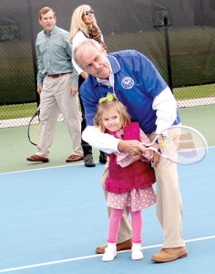 Frank Rose and his granddaughter share in the first ceremonial volley at the newly dedicated Rose Family Tennis Complex at Chowan University. | Contributed Photo