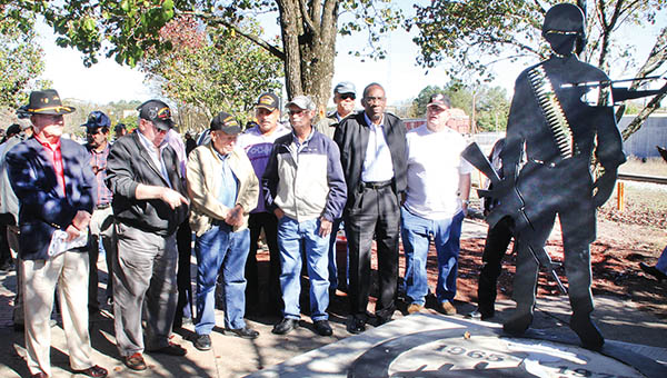 Vietnam veterans flank the new Vietnam Veterans Memorial that was dedicated Wednesday morning during a ceremony held at No Man's Land Park in downtown Ahoskie. | Staff Photos by Cal Bryant