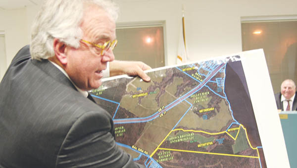 Bertie County Economic Development Director Steve Biggs points to the 137-acre tract of land (yellow border) near the Albemarle Sound that the county has purchased for $1.25 million that will be developed for recreation and tourism.   Photo by Gene Motley
