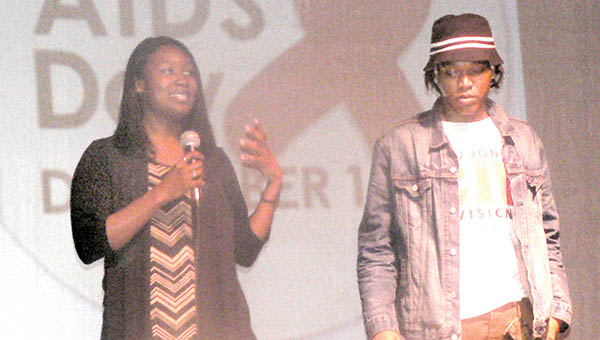 Local filmmakers CJ Jones (above) and Tommy Hurdle (below) showcased their films during the World Aids Day event held last week at the Gallery Theatre in Ahoskie. Shown at left in the top photo is Christina Thomas, an actress in Jones' films. | Photos by Kim Bunch Hoggard