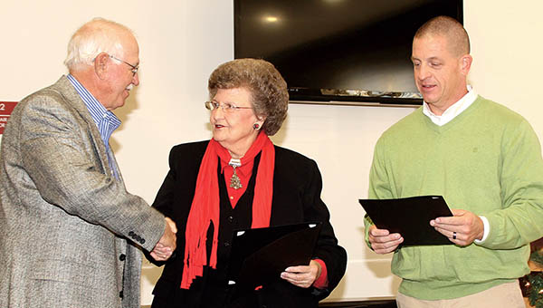 Retiring Ahoskie Town Councilwoman Elaine Myers and outgoing Mayor Brien Lassiter (right) were each given a Resolution of Appreciation on Tuesday for their respective terms of service. Making the presentations was new Ahoskie Mayor Jimmy Rowe (left). | Staff Photo by Cal Bryant