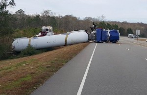 The tanker truck is shown here just prior to being up-righted onto its wheels. Photo courtesy of Jodey Sary