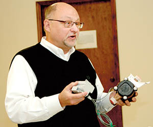 Bertie County Manager Scott Sauer demonstrates the new water meters some Lewiston-Woodville residents could have installed with the transition to the county water system.  Some town water meters were as much as 50 years old.