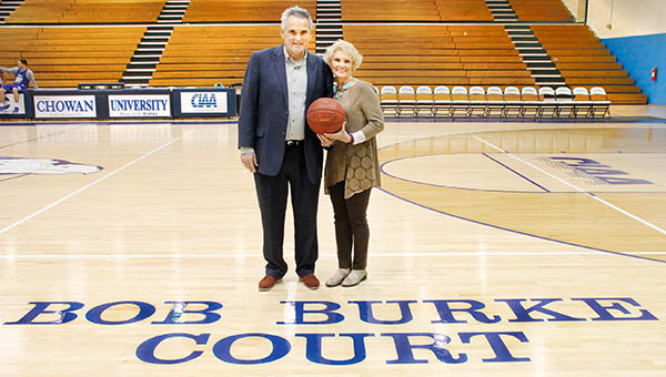 Former Chowan University head basketball coach Bob Burke stands proudly with his wife on the court at the Helms Center that now bears his name. | Staff Photos by Cal Bryant