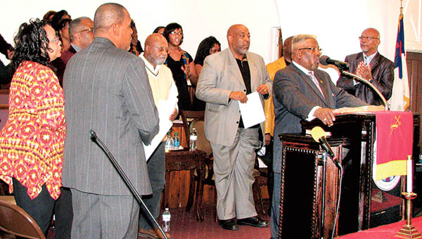 The Rev. John W. Felton (at microphone) introduces his fellow pastors that took part in Monday's celebration of Rev. Dr. Martin Luther King Jr.'s birthday held at Zion Bethlehem Baptist Church in Windsor.   Staff Photos by Keith Hoggard