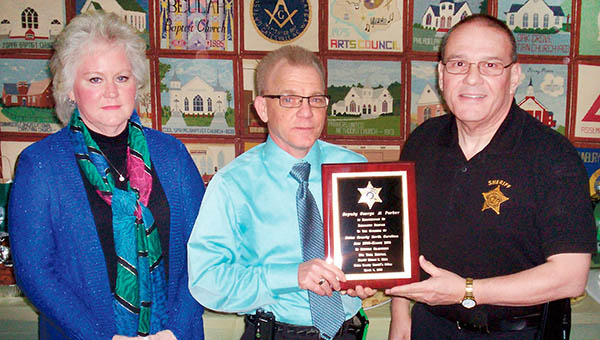 Joined by his wife Glynda, retired deputy Al Parker (center) receives a plaque of appreciation from Gates County Sheriff Ed Webb. | Photo by Bobby Eure
