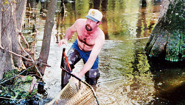 Back in a time when herring were plentiful in the Vaughan's Creek area of Hertford and Northampton counties, scenes such as this – using a dip net for catching the tasty fish – were commonplace.
