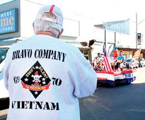 Vietnam veteran Larry Meeks watches as a patriotic float passes by during a parade in downtown Ahoskie on Friday that preceded the Veterans Day ceremony at No Man's Land Park.