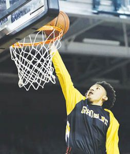 Evan Simmons drops a basket during warm-up drills Friday night before the Grambling State-East Carolina basketball game.  Simmons, a former star at Hertford County High, is in his first season of college ball with the Tigers