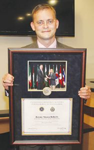 Lt. Roberts holds his FBI National Academy graduation photo with FBI Director James Comey and the diploma acknowledging his 10 weeks of training. He's the first Ahoskie law enforcement officer to undergo the process.