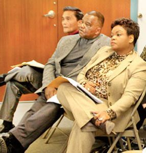From left, Bertie Board of Education members Bob Occena, Barry McGlone and Tarsha Dudley listen while the county commissioners make their presentations at Monday's joint meeting.