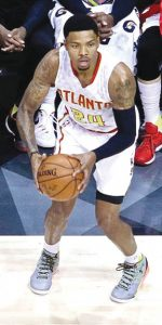 Kelford native and NBA Atlanta Hawks star Kent Bazemore (#25, with ball) will have his college jersey retired Dec. 10 at Old Dominion University in Norfolk. | Dynamic Photo / William Anthony