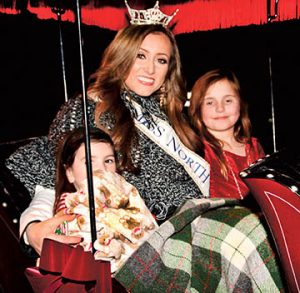 Special guest Miss North Carolina - McKenzie Faggart – is shown arriving in a horse and carriage accompanied by Claire and Alice Braswell.