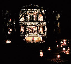 Candles light the way to the historic Camp-Hill-Gary House, which was one of three new stops on this year's tour.