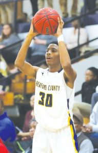 Hertford County's Talik Totten looks to pass in a recent basketball game.  Totten tallied 18 points Friday night to help the Bears defeat Currituck County 72-43. | Dynamic Photo / William Anthony