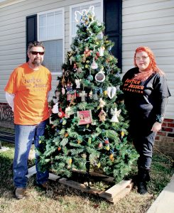 Lizbeth and Robert Futrell stand adjacent to a Christmas tree outside their Northampton County home, one covered in special ornaments, to include angel figurines, in memory of their daughter who died by her own hand earlier this year. Staff Photo by Cal Bryant