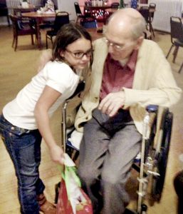 Mackenzie (above) and Laura (below) Bryant are shown visiting with residents at Pine Forest Rest Home in Potecasi where the two sisters delivered personalized Christmas gifts on Dec. 19. Contributed Photos