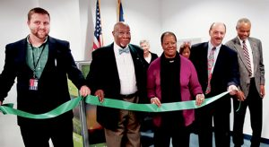 A ribbon-cutting ceremony was held last week at the Northampton County Department of Social Services in Jackson to formally open a Mental Health screening kiosk. Those taking part in the event included Assistant County Manager Nathan Pearce, County Commissioners Robert Carter and Fannie Greene, and Bland Baker of Trillium Health Resources.