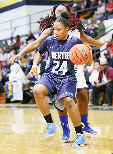 Bertie's Akyia King (#24) was named MVP after she scored a season-high 29 points as the Lady Falcons won their 16th Roanoke-Chowan News-Herald Holiday Classic championship Thursday night at Hertford County High School with a 65-23 victory over Plymouth High School.