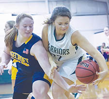 Ridgecroft School's Mackenzie Brown (left) battles Lawrence Academy's Brinson Edmondson for a loose ball in Tuesday night's TIC game in Merry Hill.  Lawrence won 46-45 to break the Lady Rams' 16-game conference winning streak. | 2nd Chance Productions / Andre Alfred