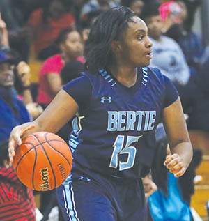 Jomiya Early directs traffic in Friday night's Bertie road game with Hertford County.  Early scored seven points as the Lady Falcons ran their record to 14-0 with a 65-27 victory.  | Dynamic Photo / William Anthony