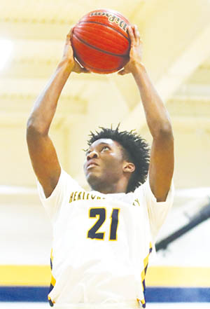 Rayshawn Beamon uses both hands to grab and secure a rebound in Tuesday night's 94-60 Hertford County win over Northwest Halifax. | Dynamic Photo / William Anthony