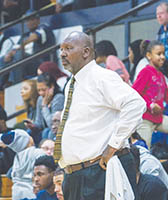 Hertford County basketball coach Charles Simmons watches the action in a recent game.  The Bears downed First Flight in overtime 83-75 Friday night to remain unbeaten in conference play. | 2nd Chance Productions / Andre Alfred