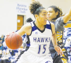 Chowan's Jordan Payne (#15) drives on a Bowie State defender in Saturday's CIAA game in Murfreesboro.  Despite Payne's 22 points and 12 rebounds, the Lady Hawks lost in overtime, 75-70. | Next Level Photos / Charles Revelle
