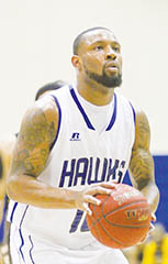 Chowan's Jeremy Smith eyes the rim on a free throw attempt in Saturday's game with Bowie State.  The Hawks made 15-of-18 foul shots in the second half in pulling off the 59-58 win over the Bulldogs, for their 10th straight at home this season. | Next Level Photos / Charles Revelle