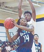Bertie's Eric Speight (#14) drives on a Hertford County defender in a recent game.  Speight's 10-point night was not enough for the Falcons Friday as they fell to Currituck 49-33. | 2nd Chance Productions / Andre Alfred