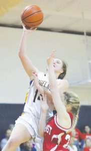 Ridgecroft School's Reagan King (in white) is fouled by Northeast Academy's Addie Piper on a lay-up attempt in Tuesday night's TIC basketball game.  The Lady Rams won 47-8. | Dynamic Photo / William Anthony