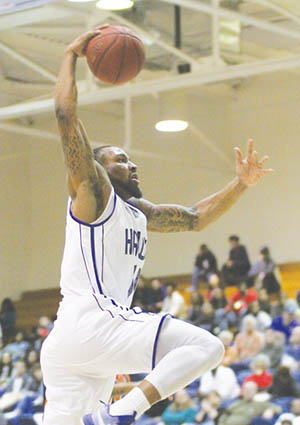 Chowan's Jeremy Smith goes airborne for one of his two slam-dunks Wednesday night against Lincoln University in a 96-76 Hawks win in CIAA action at the Helms Center.  It was Chowan's 11th straight home win. | Photo by Qui'Wania Miller