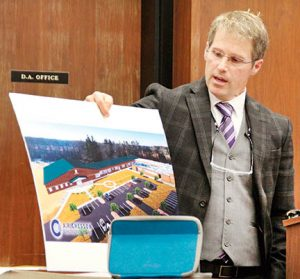 Dr. Barry Williams, Superintendent of Gates County Public Schools, shows one of six construction/renovation options he presented to the county commissioners last week.