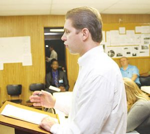 Chris Hilbert of Holland Consulting Planners briefs Bertie County Commissioners at their Powellsville meeting Tuesday night on the application process property owners need complete for relief claims for damages suffered from 2016 storms Julia and Matthew. | Staff Photo by Gene Motley