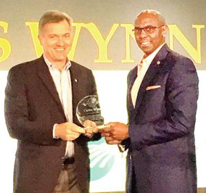 Roanoke Electric Cooperative CEO Curtis Wynn (right) accepts the J.C. Brown CEO Communication Leadership Award from Jim Matheson, CEO of National Rural Electric Cooperative Association. | Contributed Photo