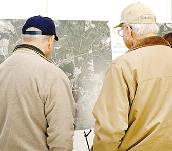 Property owners study a map of the proposed route of the Atlantic Coast Pipeline through Northampton County at a January, 2015 workshop hosted by project officials in Jackson. | File Photo