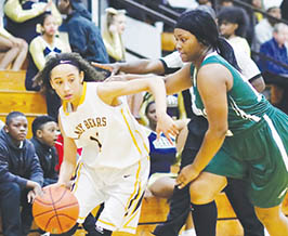 Hertford County's Breanna Howard (left) drives on Northeastern's Kalethia Harris in Tuesday night's Northeastern Coastal Conference game.  The Lady Bears' 48-42 overtime win marked the second time they downed the Lady Eagles this season. | Dynamic Photo / William Anthony