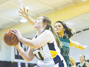 Ridgecroft School's Mackenzie Brown eyes the rim while defended by Lawrence Academy's Brinson Edmondson in Wednesday night's TIC game.  Brown celebrated Senior Night for the Lady Rams with 16 points in a 49-21 title-clinching win. | Dynamic Photo / William Anthony