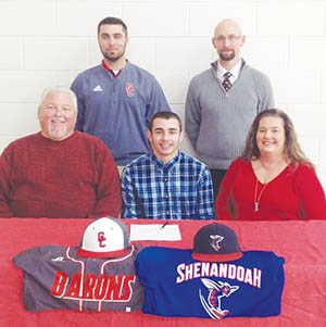 Gates County High baseball player Jordan Brinkley (front row, middle) signed his National Letter of Intent to attend Shenandoah University next fall on National Signing Day last week.  Joining Jordan were (front row, from left): uncle, Mike Harrell; and, aunt, Lenora Harrell; (back row, from left) Red Barons baseball coach Jacob Harrell; and, GCHS Principal/Athletic Director Jonathan Hayes. | Contributed Photo