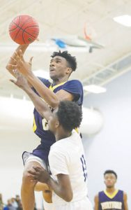 Hertford County High's Jaquarii Roberson (#23) hit for 23 points as the Bears clinched the Northeastern Coastal Conference regular-season championship Friday night in Windsor with a 68-48 win over rival Bertie High. | Dynamic Photo / William Anthony