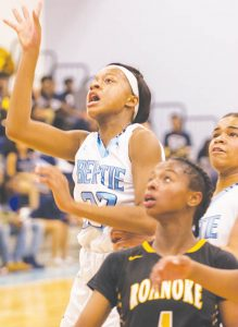 Bertie's Nyasia Barnes (left) and teammate Autum Morings (right) eye the rim with Roanoke Rapids' Anna Vann (middle) on a shot during Saturday's NCHSAA 2A playoff game.  The Lady Falcons topped the Lady Jackets 56-41 to advance to round-four today (Tuesday) in Windsor. | Photo by Angie Todd