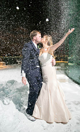 With a few flurries still falling, Mr. and Mrs. Matt Edwards share a kiss on their wedding day in Norfolk, VA.