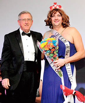 """Trixie Jo Wilcox"" (Jonathan Martin) was crowned as the Queen of the Firehouse at the conclusion of Saturday evening's pageant. ""She"" is shown with the event's emcee, Joe Barrett."