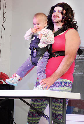 "'Wilma Winnersbe"" (Buddy Hedgepeth) uses ""her"" daughter, Clara, as a prop during the talent competition of the CVFD fundraiser."
