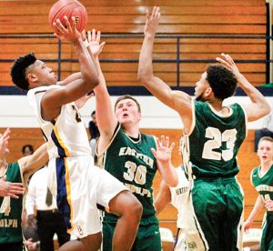 Hertford County's Lance Hunter (left) drives to the basket against Eastern Randolph defenders Nathan Cockman (#30) and Dezman Austin during Tuesday night's state play-off opener in Ahoskie. Hunter was one of five Bears to score in double figures as HCHS advanced to round two with a 106-54 victory. | Staff Photo by Cal Bryant