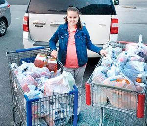 Ten-year-old Carly Piland once again displayed her big heart by taking $200 in Christmas gifts and purchasing items that she donated to the Ahoskie Food Pantry. | Contributed Photos