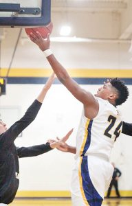 Lance Hunter (right) muscles inside for two of his 15 points that helped Hertford County beat Roanoke Rapids and earn the Bears a spot in tonight's (Tuesday) Eastern Class 2-A semifinals. | Staff Photo by Cal Bryant